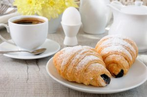 Croissants filled with dark chocolate will be sure to satiate your customers' sweet tooth.